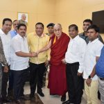 His Holiness Dalai Lama seen being greeted by the Protocol Minister, Shri Mauvin Godinho on his arrival at Goa Airport, Dabolim on December 10, 2019.