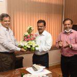 Shri. Dipak Bandekar is seen presenting a bouquet of flowers to Shri. Ramesh Naik